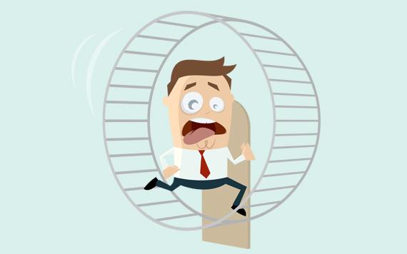 Unternehmer läuft angestrengt im Hamsterrad