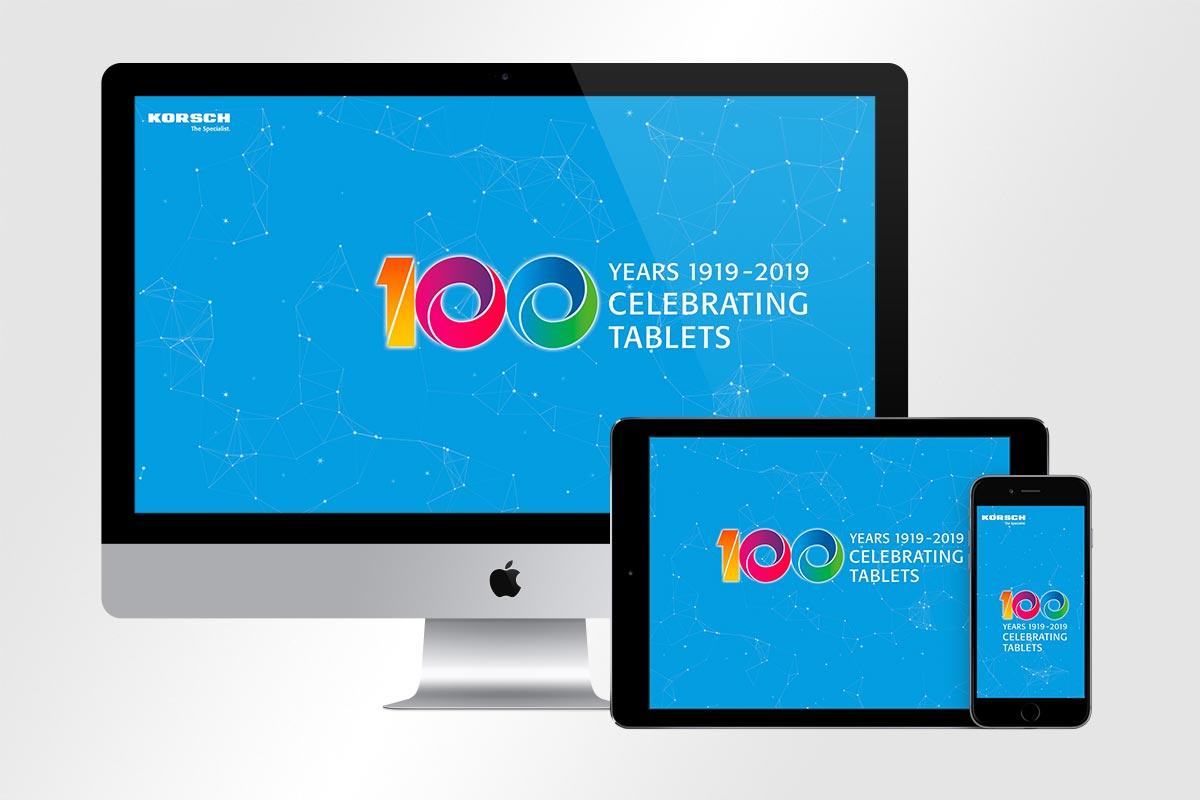 farbiges 100-Jahre-Logo vor blauem Hintergrund